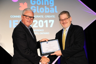 Mr. F. Michael Langley, FM, CEO of GREATER MSP, Minneapolis–St. Paul, MN, and 2017 IEDC Board Chair, awards the Silver Excellence in Economic Development Award to URA Executive Director Robert Rubinstein.